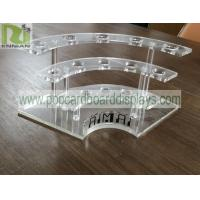 China customized POP clear acrylic display stands with holes for bottles PS material for sale