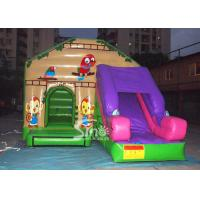 China Commercial backyard jungle theme kids inflatable jumping castle with slide made of best pvc tarpaulin for sale