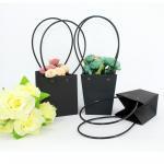 Waterproof Flower Packaging Carry Kraft Paper Bag With Plastic Handle for sale